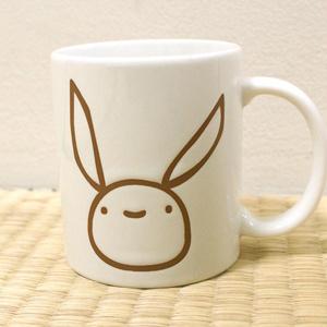 サイトウサンのマグカップ