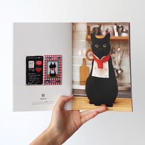 セット売り「クロネコと首輪」作品集とポストカード+マグネット
