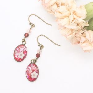 ピンクのキラキラお花レジンピアス
