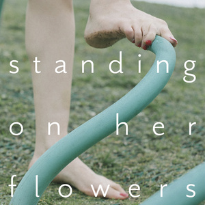 standing on her flowers