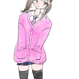 ピンク色のカーディガン