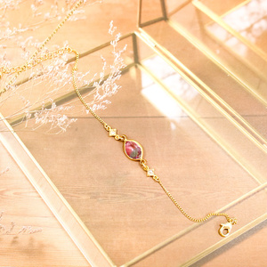 グラデーションクリスタルガラスのブレスレット ピンク×スカイブルー ゴールド金具