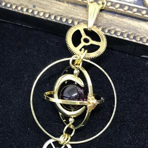 《クロノスの環》ガーネット・ゴールド