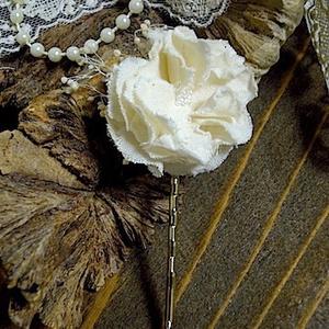 white flower pin