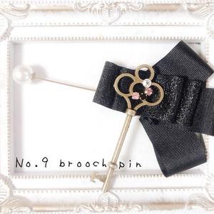 Key brooch pin